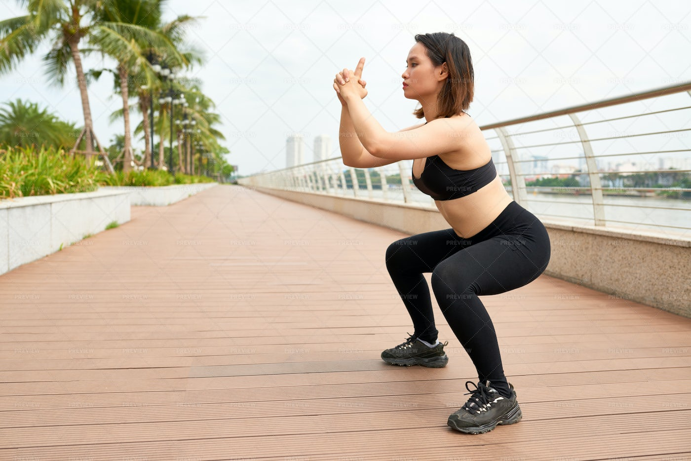 Sportive Woman Working Out On Street: Stock Photos