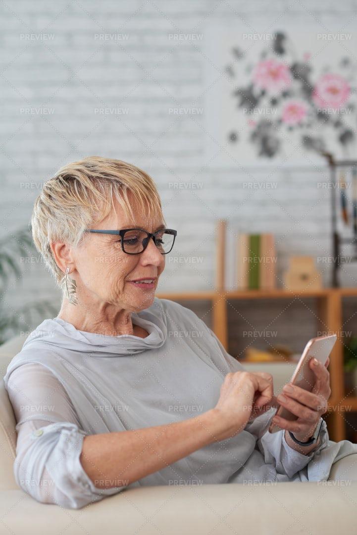 Senior Woman Using Mobile Phone: Stock Photos