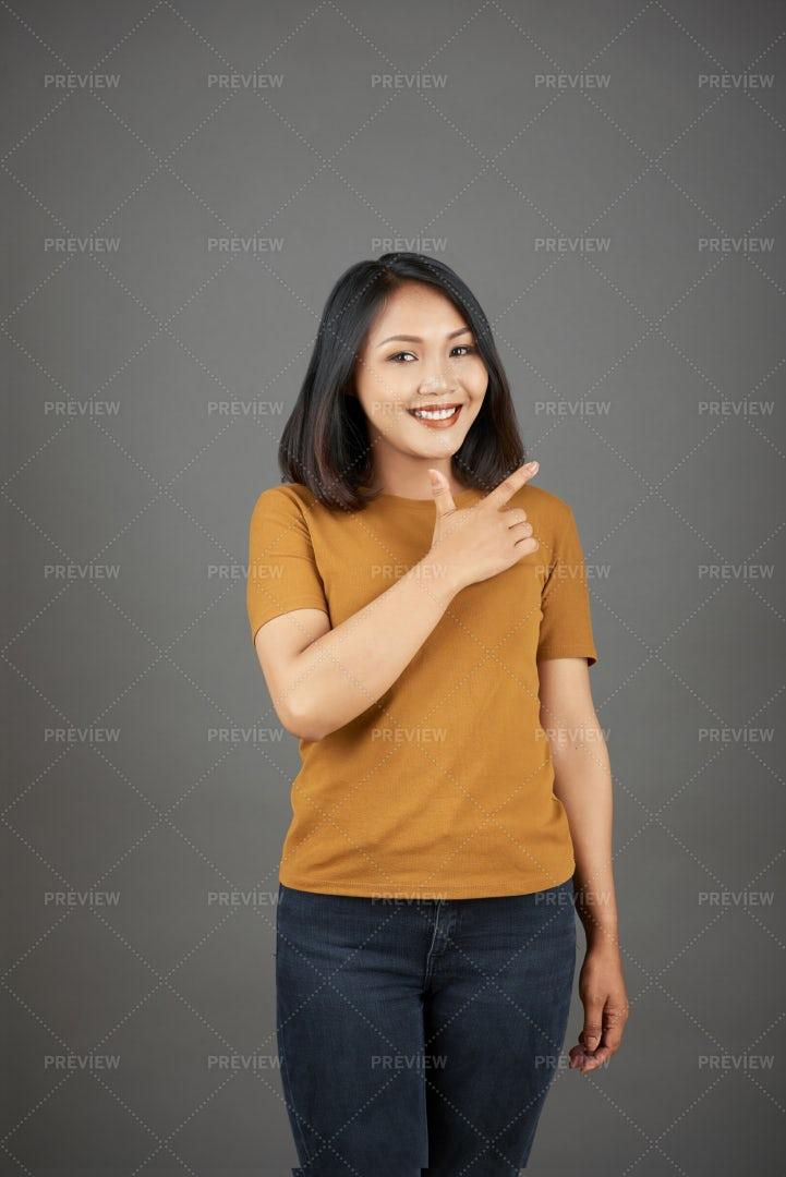 Beautiful Asian Woman Posing At Camera: Stock Photos
