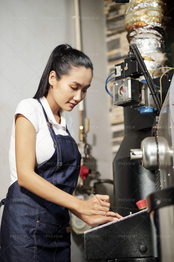 Factory Worker Working With Machine: Stock Photos
