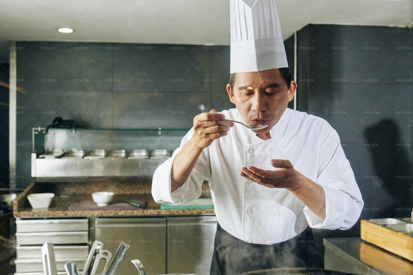 Chef Tasting His Dsih: Stock Photos