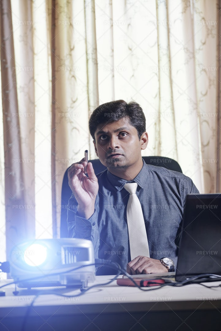 Businessman Using Projector For: Stock Photos