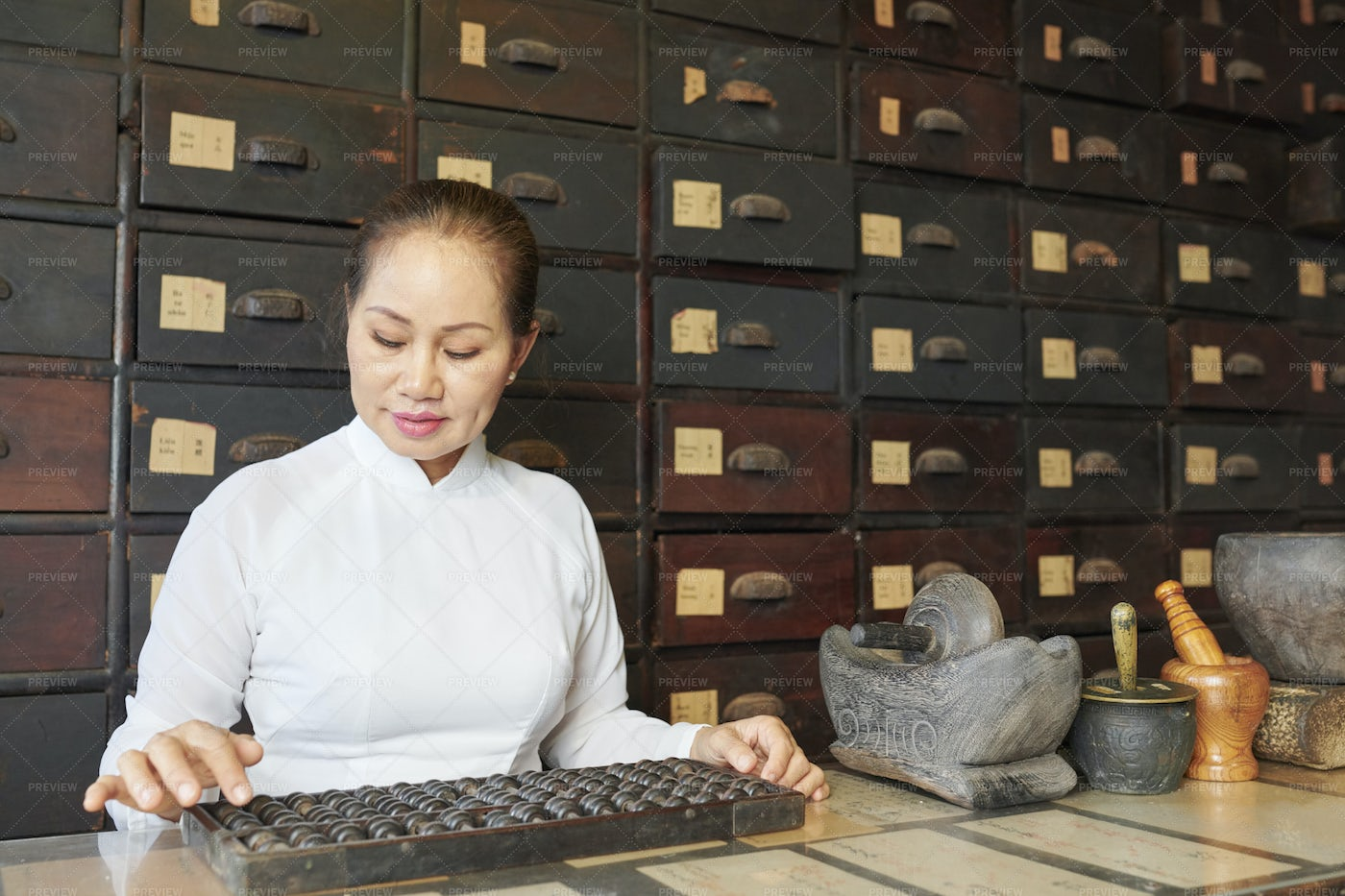 Woman Working At Old Apothecary: Stock Photos