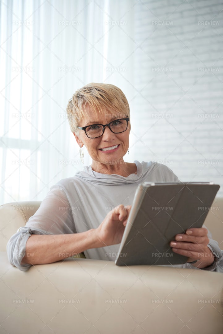 Woman Working Online On Tablet Pc: Stock Photos