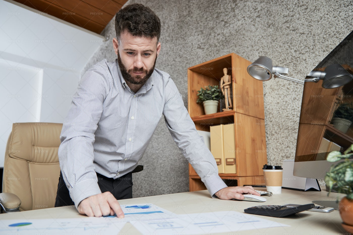 Man Examining Marketing In Business: Stock Photos