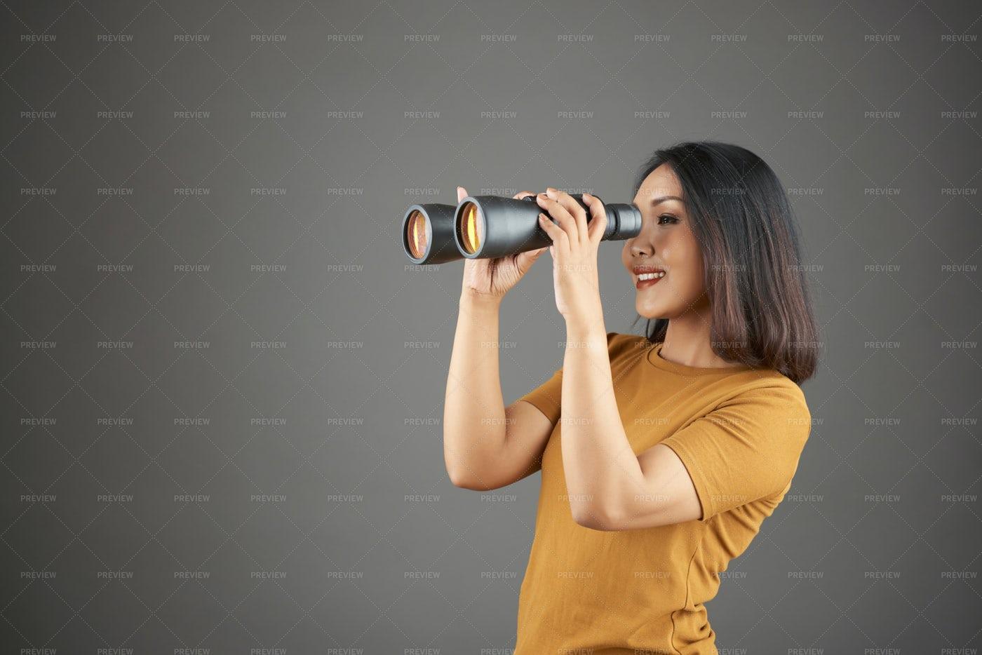 Woman Observing Through Binoculars: Stock Photos