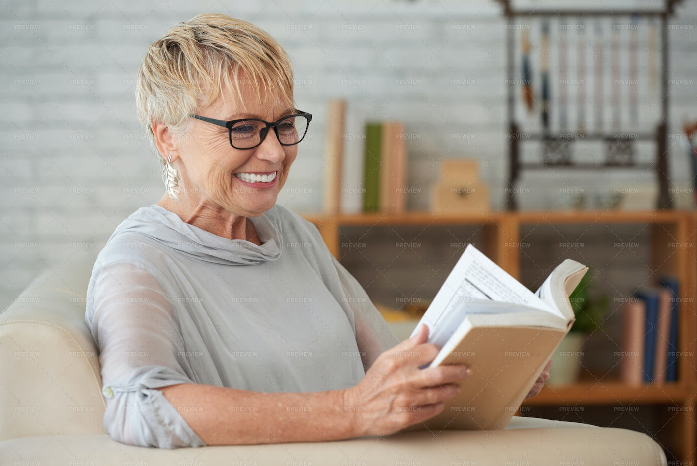 Woman Resting With Book At Home: Stock Photos