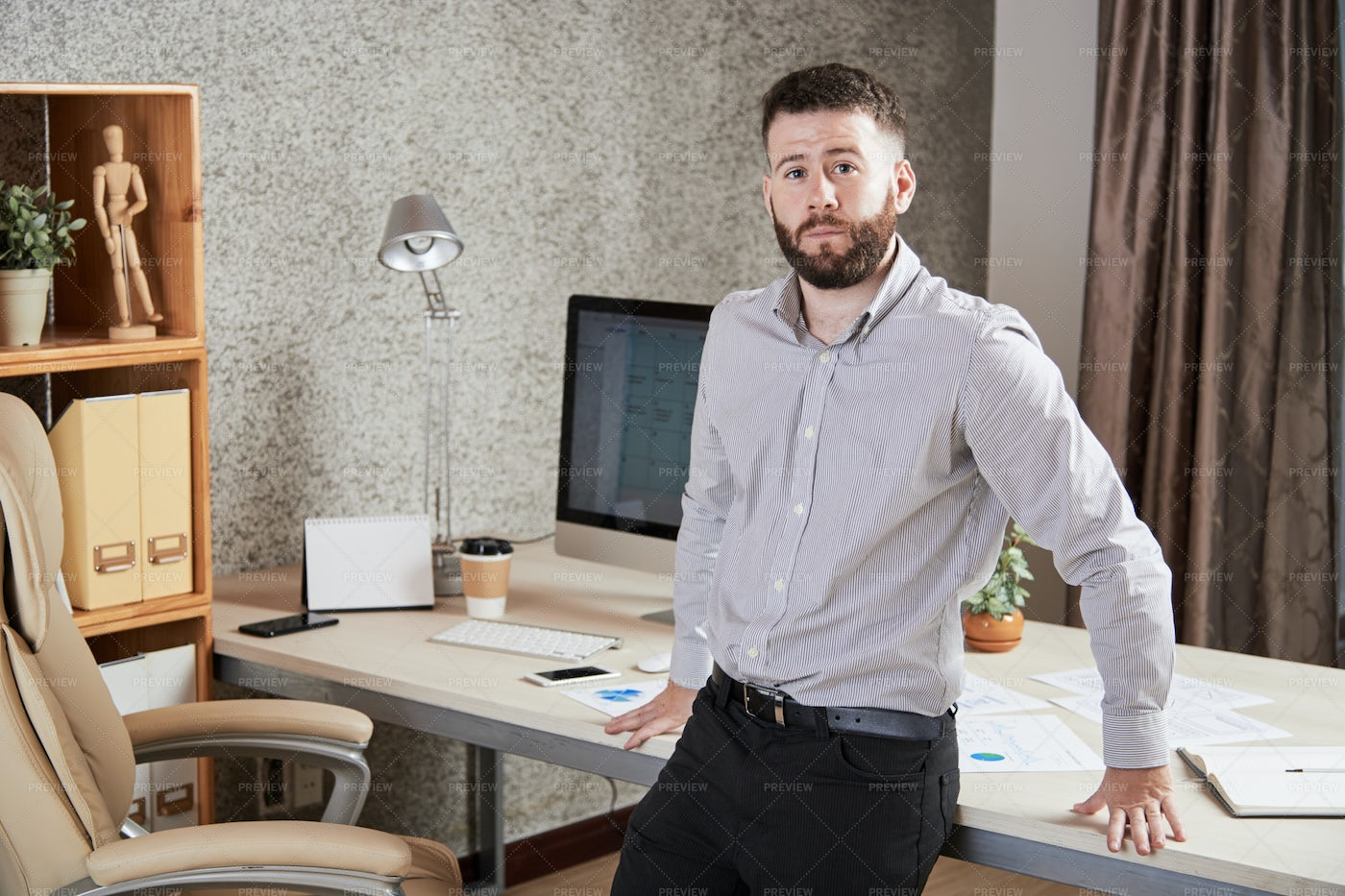 Young Businessman Standing At Office: Stock Photos