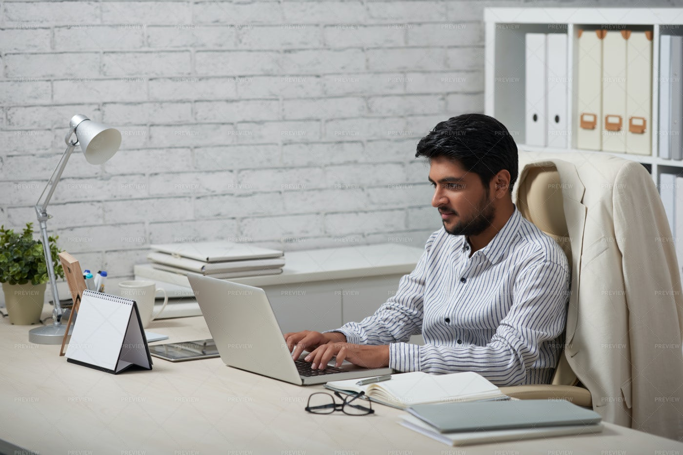 Young Businessman Working In Office: Stock Photos