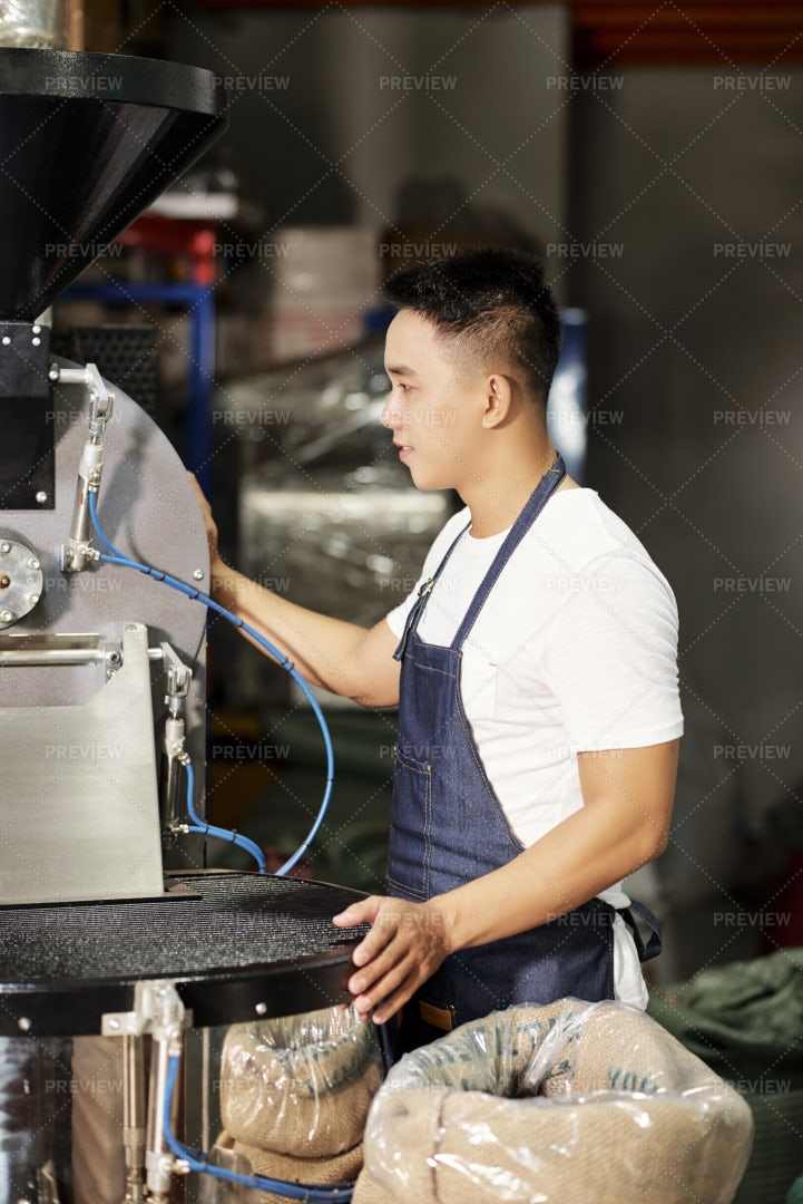 Factory Worker Working On Coffee: Stock Photos