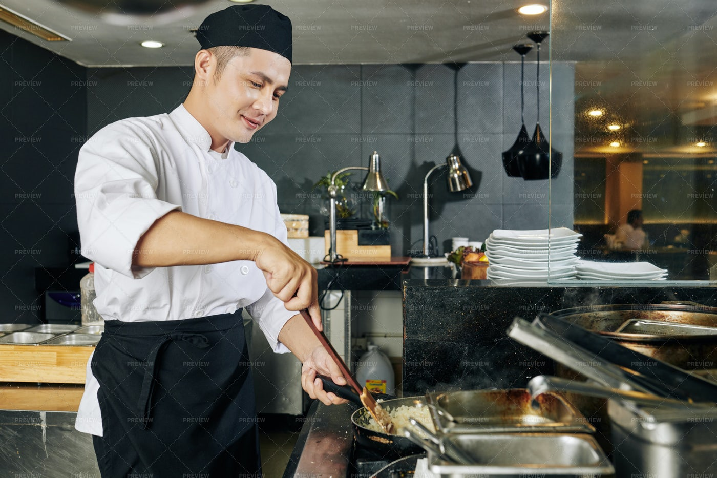 Asian Chef Preparing Dish: Stock Photos