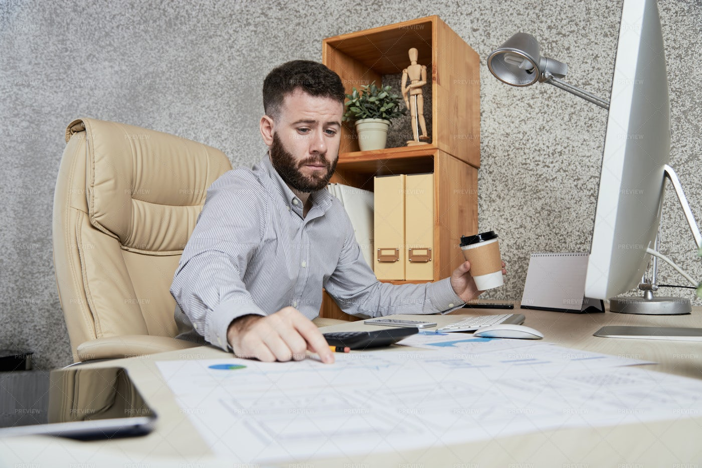 Businessman Working With Documents At: Stock Photos