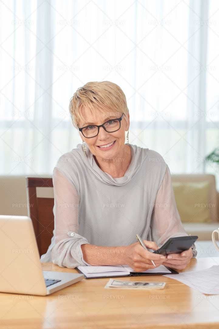 Woman Counting Her Finance: Stock Photos