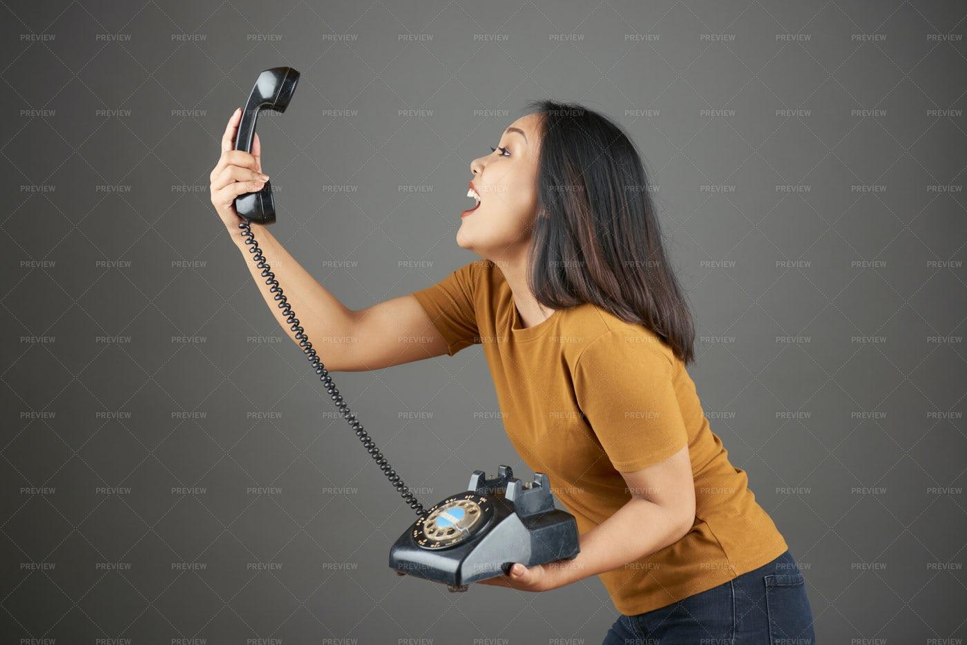 Woman Holding Retro Phone: Stock Photos