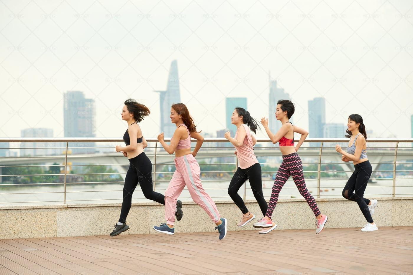 Running Sportswomen On Seafront: Stock Photos