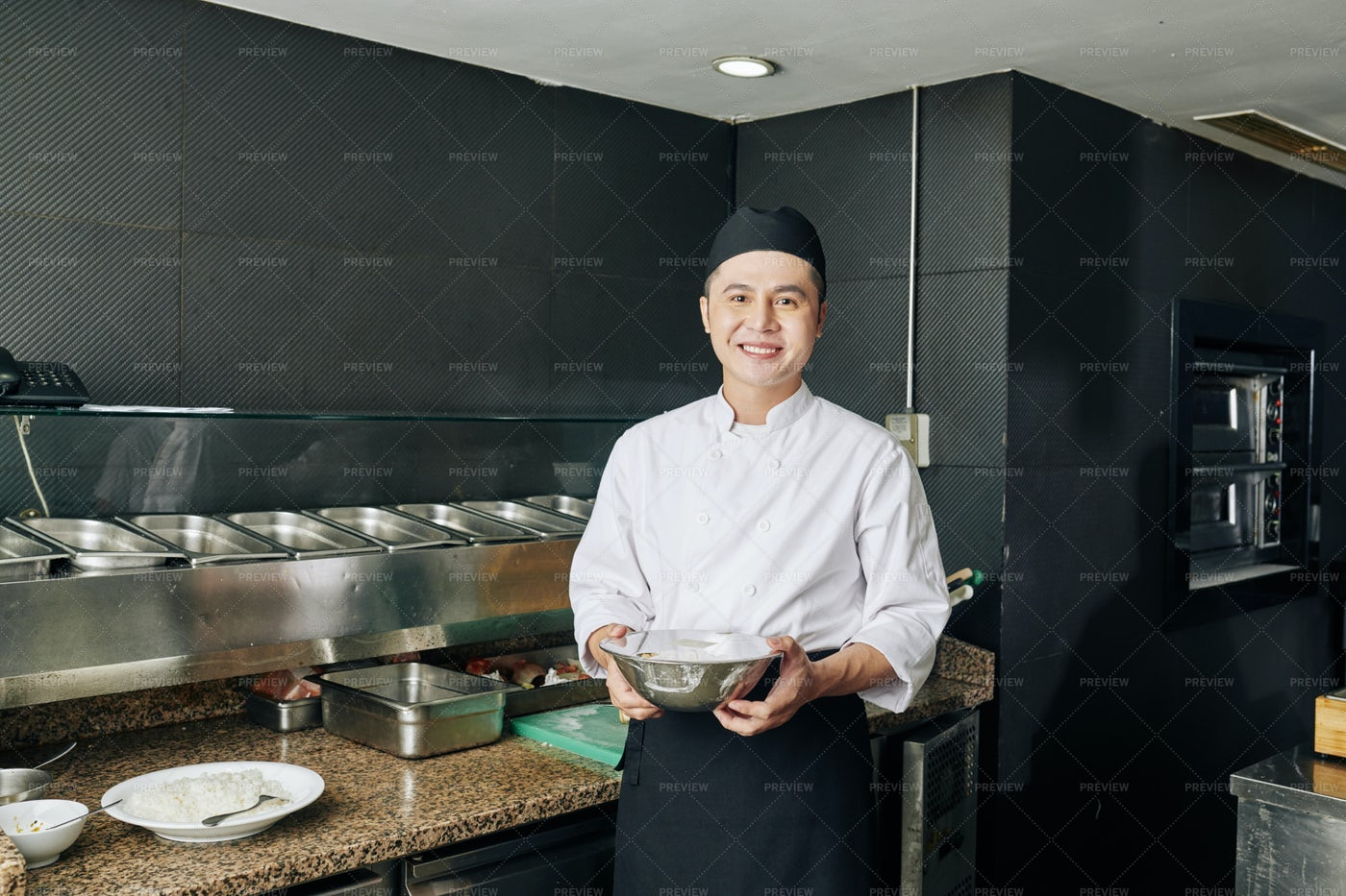 Asian Cook Working At The Restaurant: Stock Photos