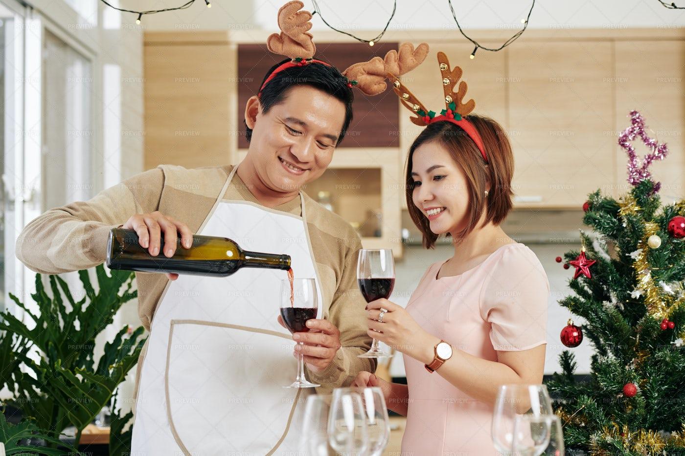 Man Pouring Wine On Christmas Eve: Stock Photos