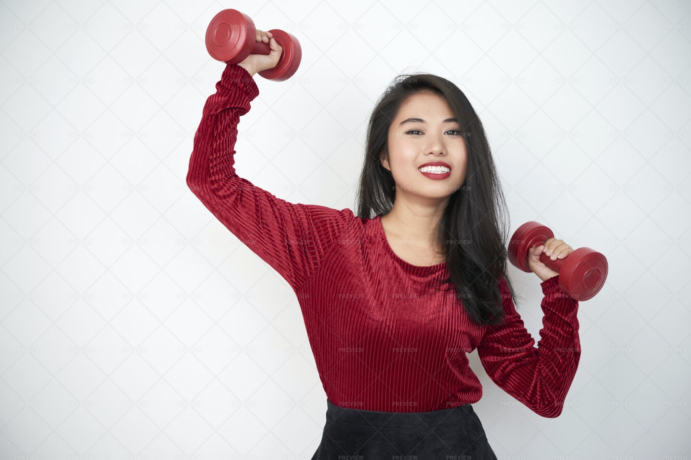 Woman Exercising With Dumbbells: Stock Photos