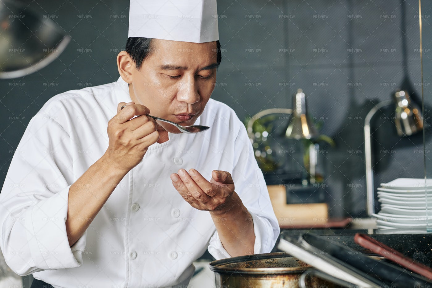 Cook Tasting The Dish: Stock Photos