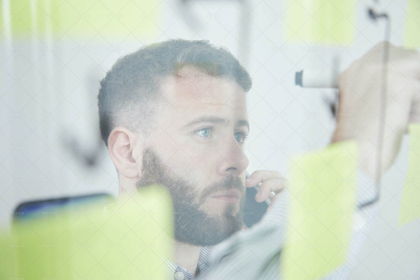 Man Writing A Note At Office: Stock Photos