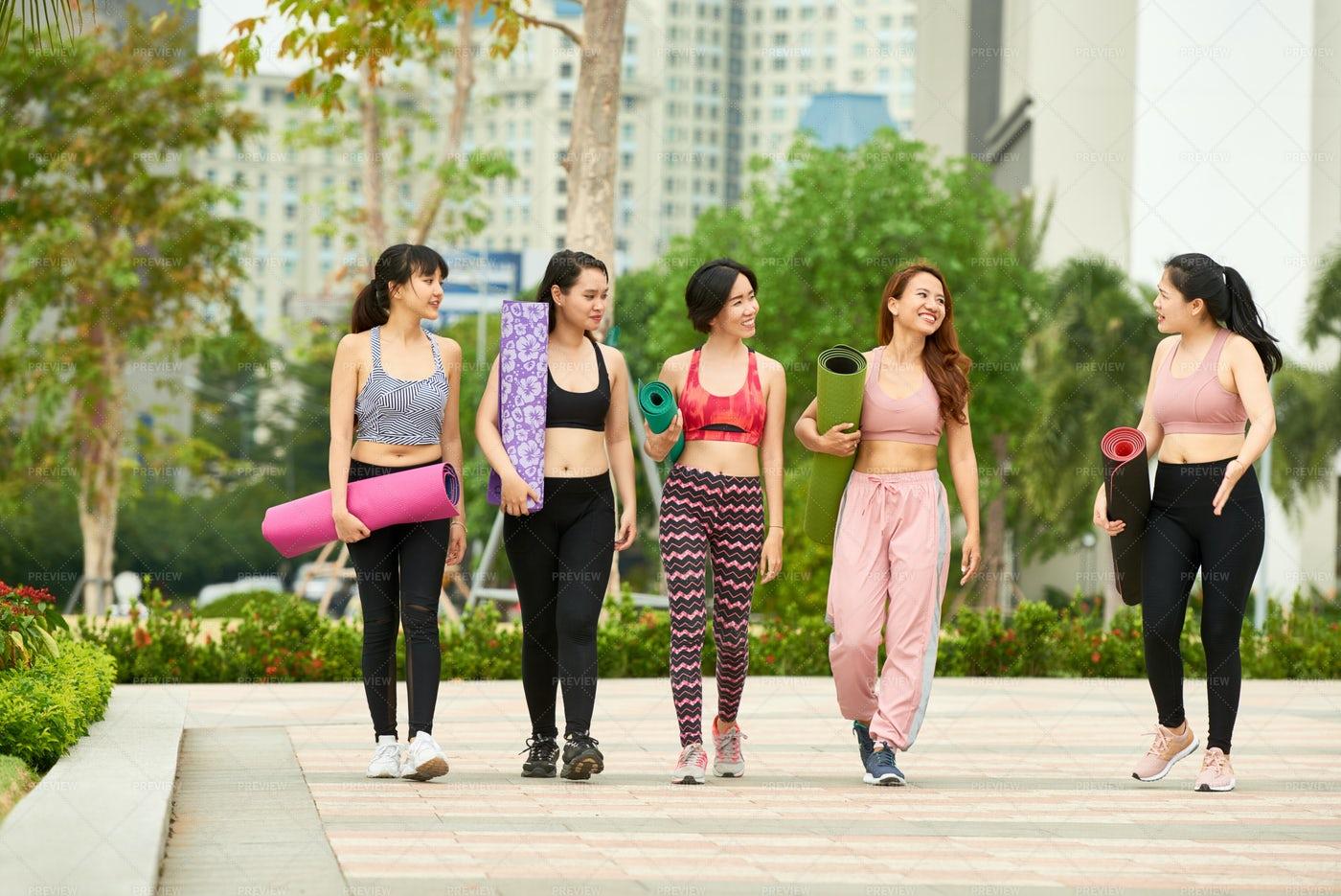 Group Of Women With Yoga Mats Outdoors: Stock Photos