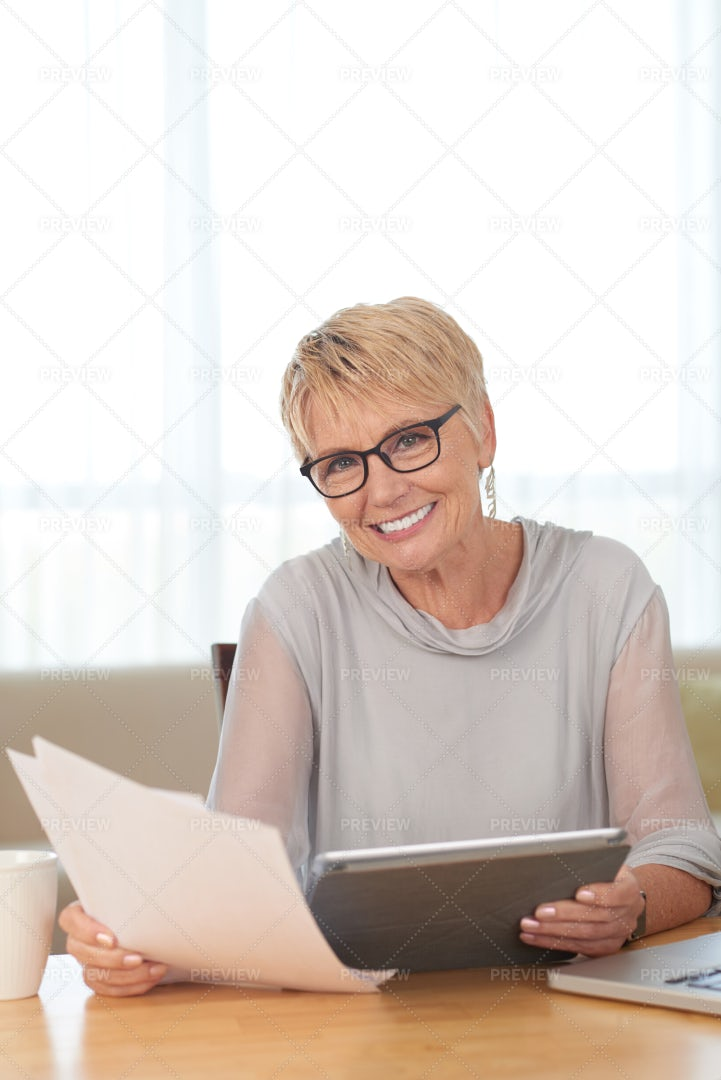 Mature Woman With Tablet Pc At Home: Stock Photos