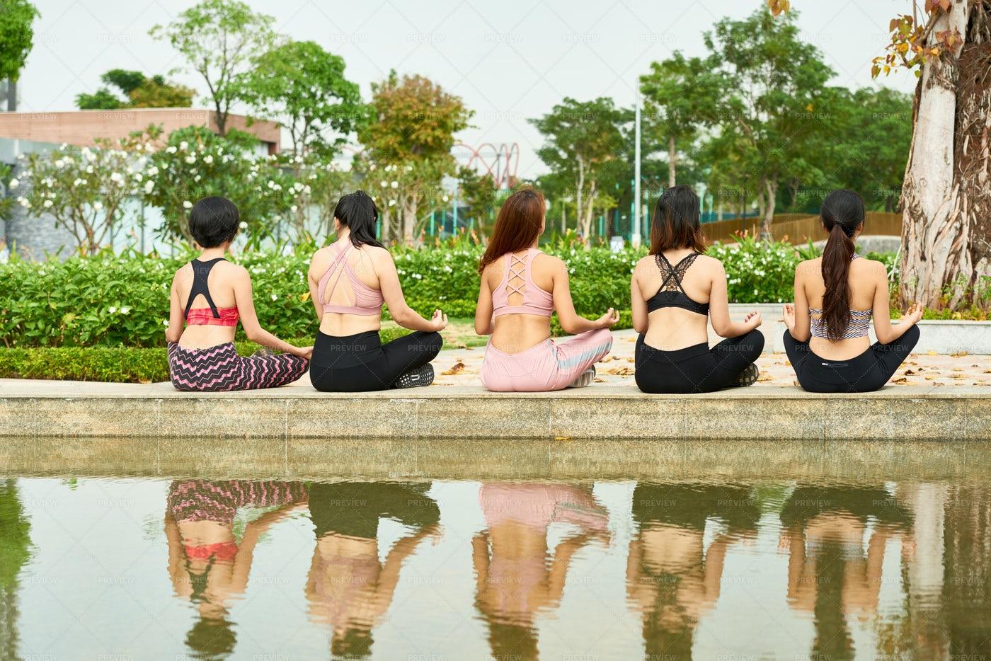 Women Meditating In Summer Park: Stock Photos