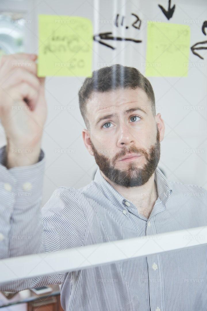 Man Writing A Reminder On Notes: Stock Photos