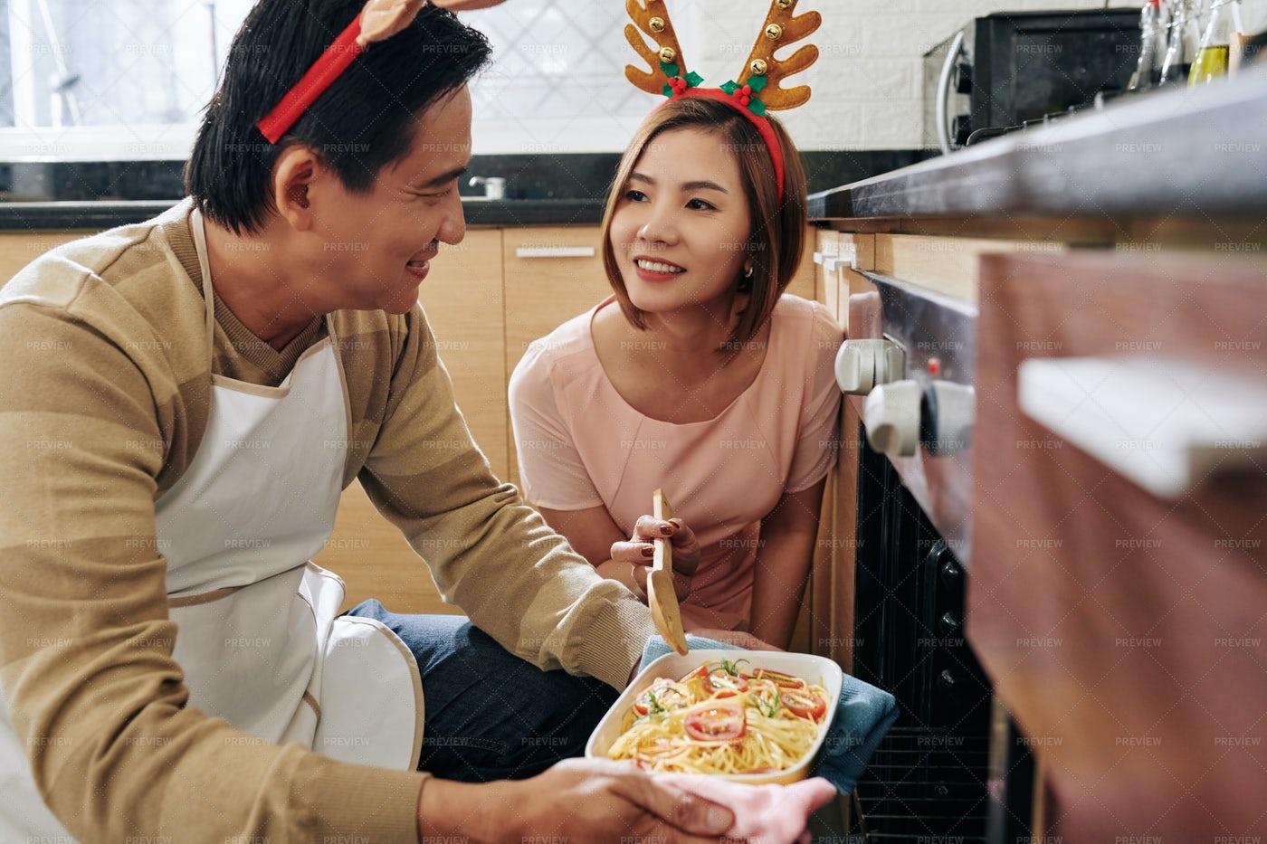 Couple Cooking Christmas Spaghetti: Stock Photos