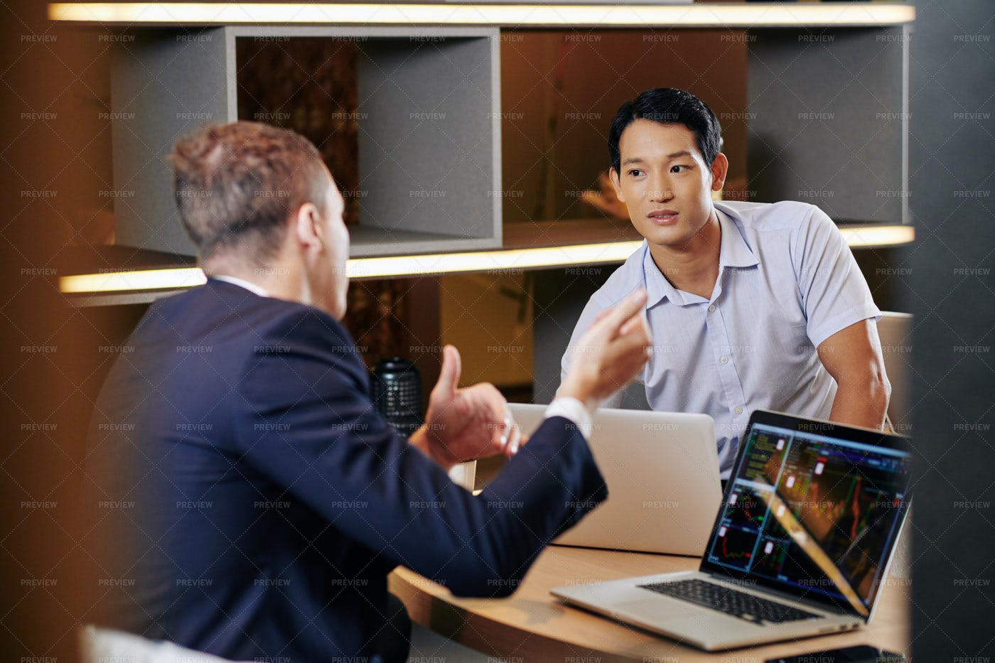 Businessman Listening To Coworker: Stock Photos