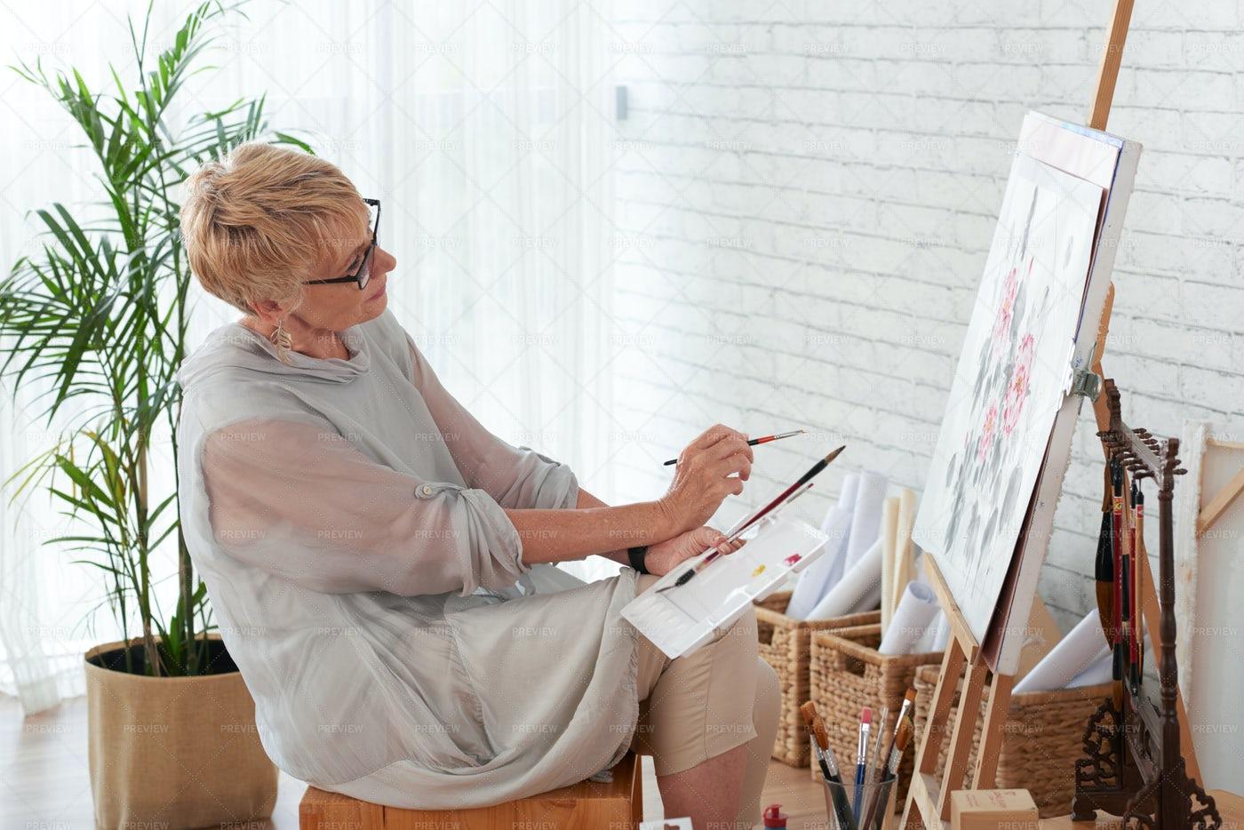 Mature Woman Painting In Art Studio: Stock Photos