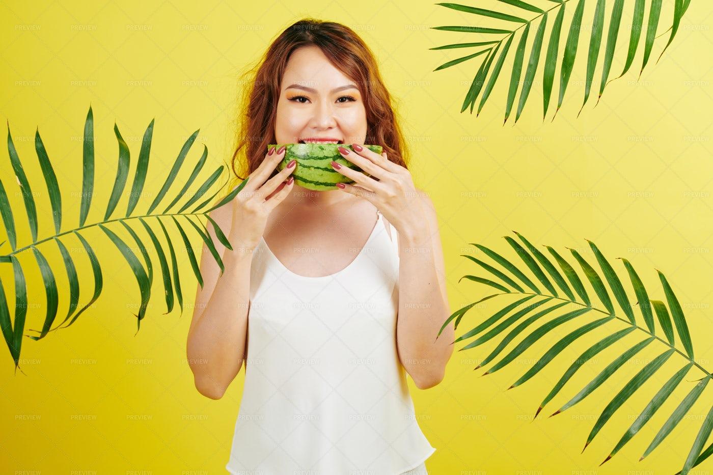 Woman Eating Watermelon: Stock Photos