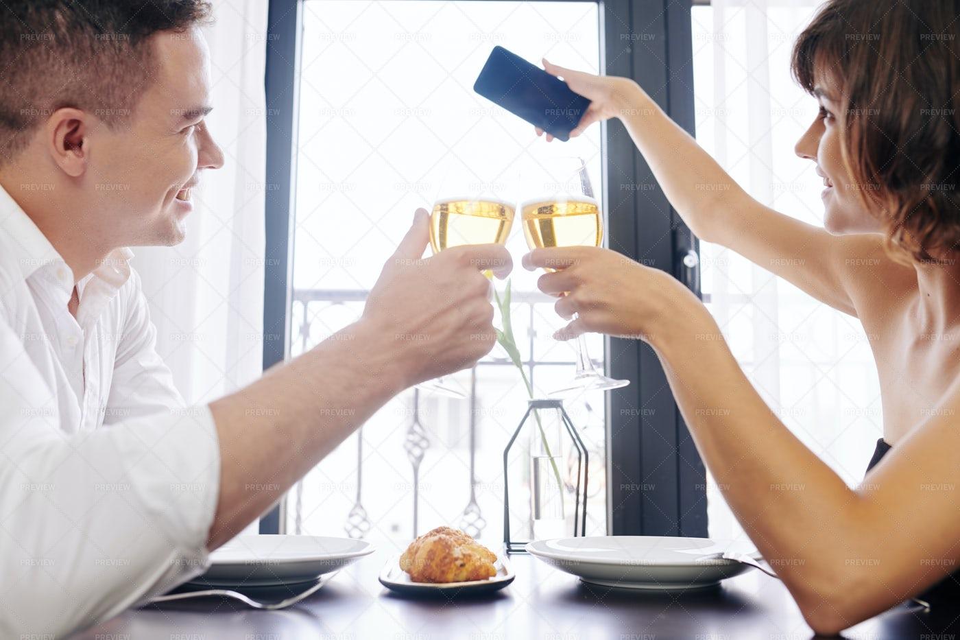 Couple Drinking Wine In Restaurant: Stock Photos