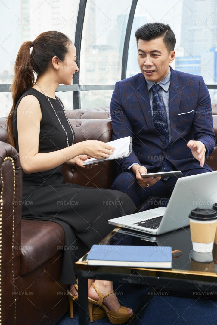 Business Colleagues Discussing Plans: Stock Photos