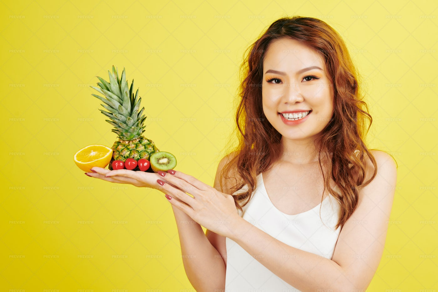 Woman With Tropical Fruits: Stock Photos