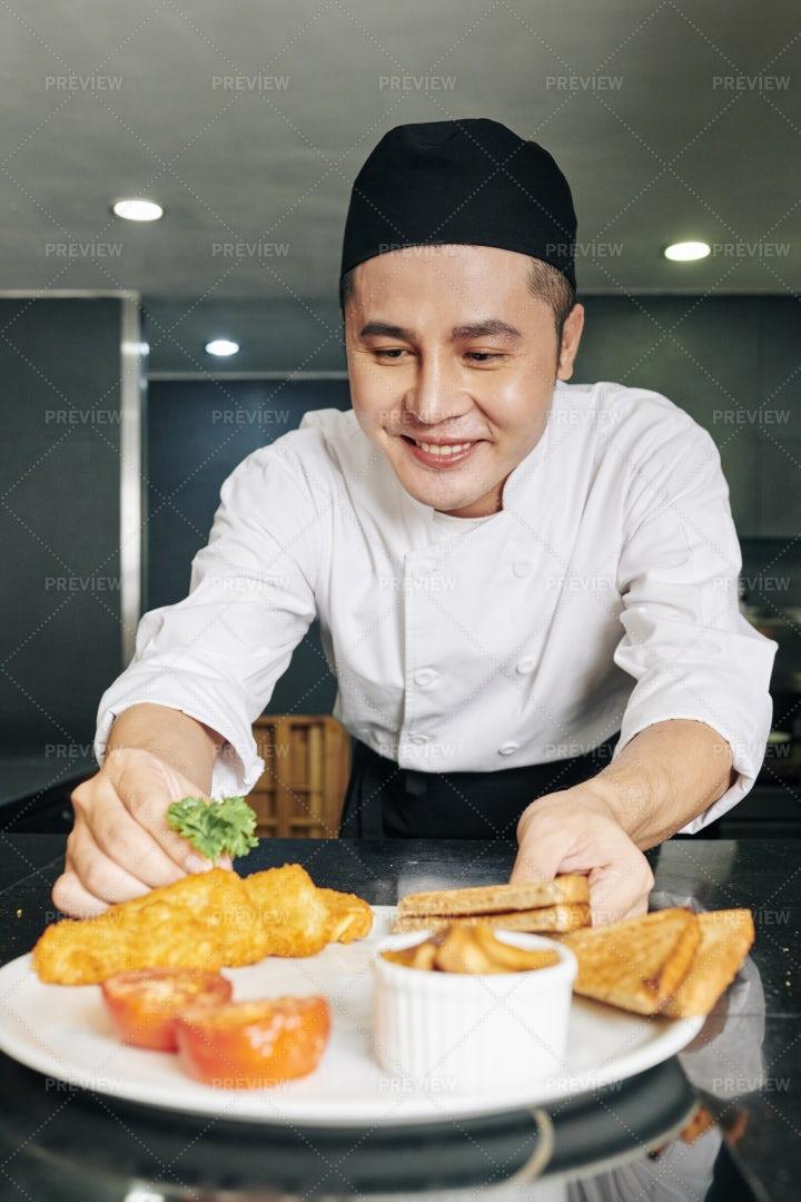 Coook Decorating His Dish: Stock Photos