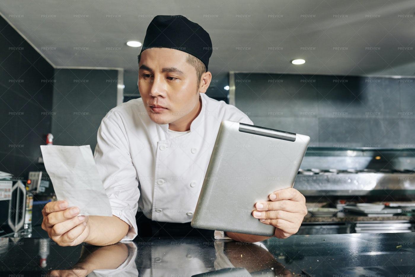 Chef Reading A Recipe: Stock Photos
