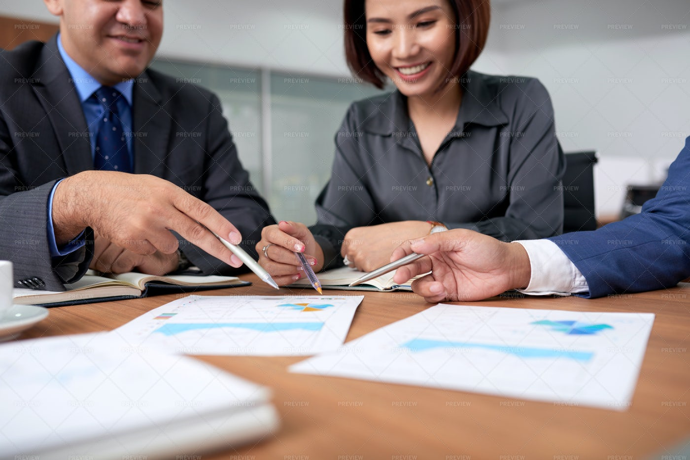 Business People Analyzing Financial: Stock Photos
