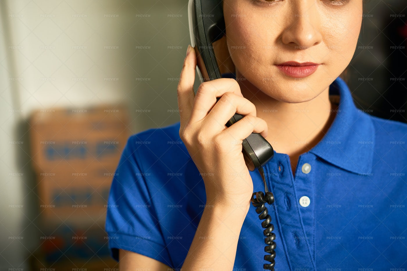 Shop Assistant On Phone: Stock Photos
