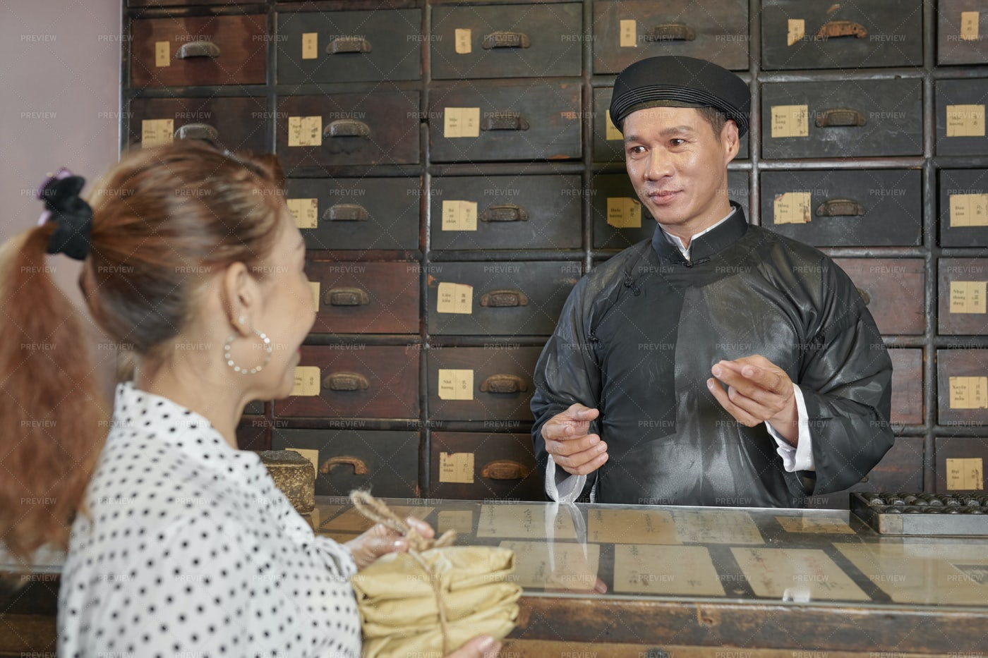 Asian Medicine Practitioner Consulting: Stock Photos