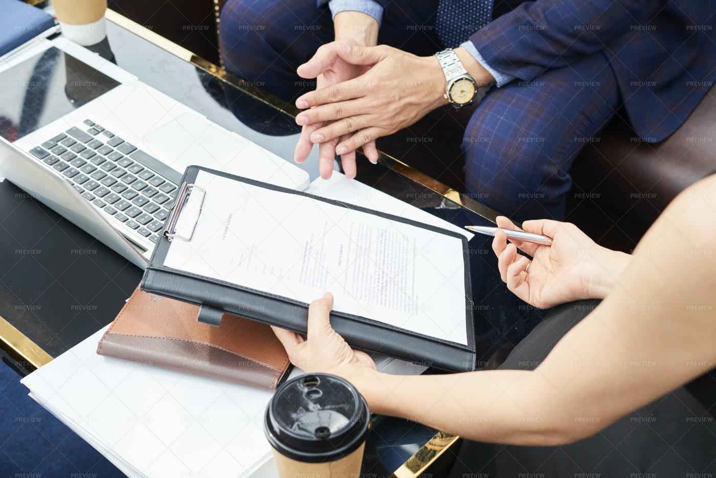 Discussing Partnership Agreement: Stock Photos