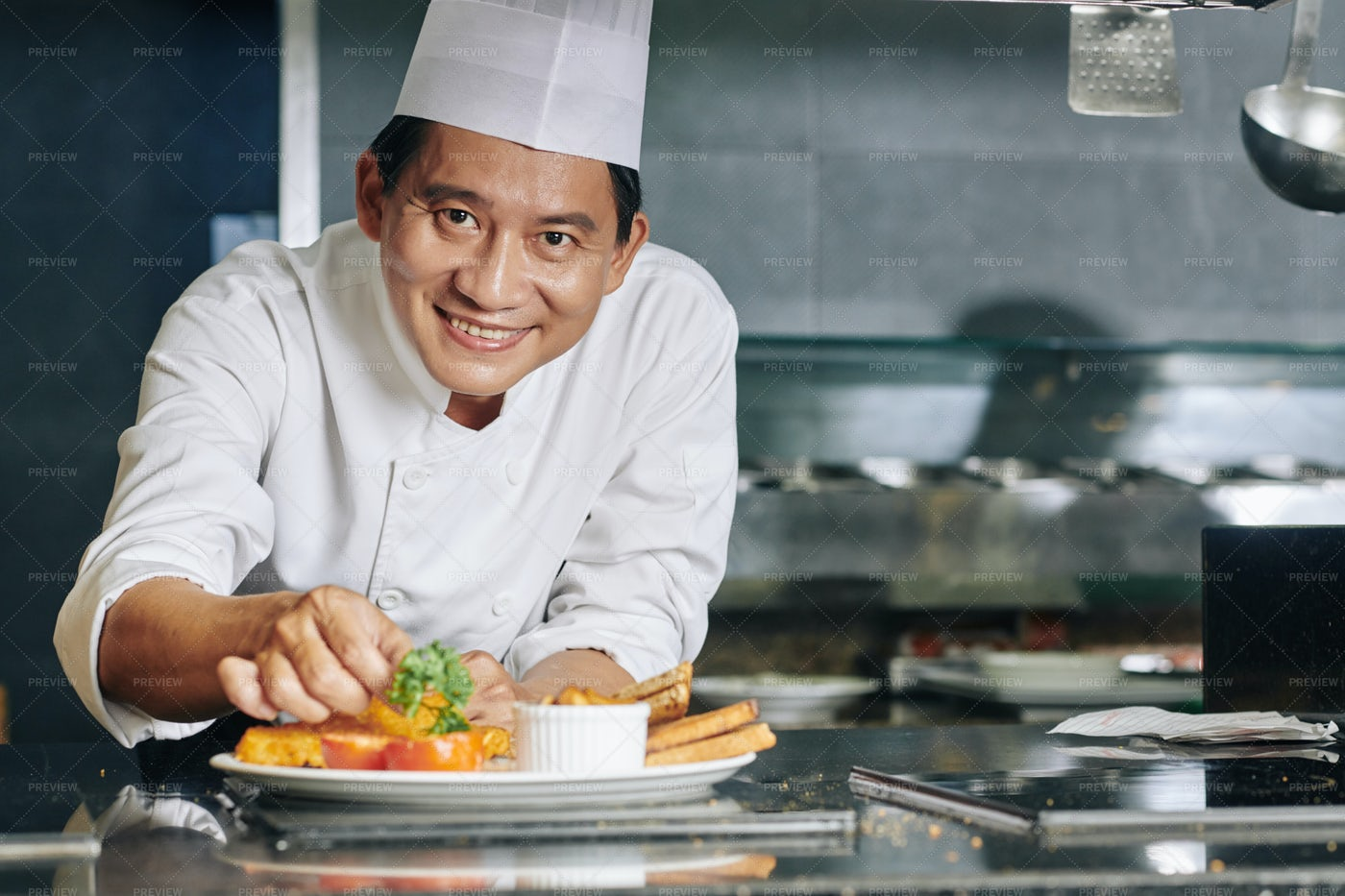 Asian Chef With Dish At The Restaurant: Stock Photos