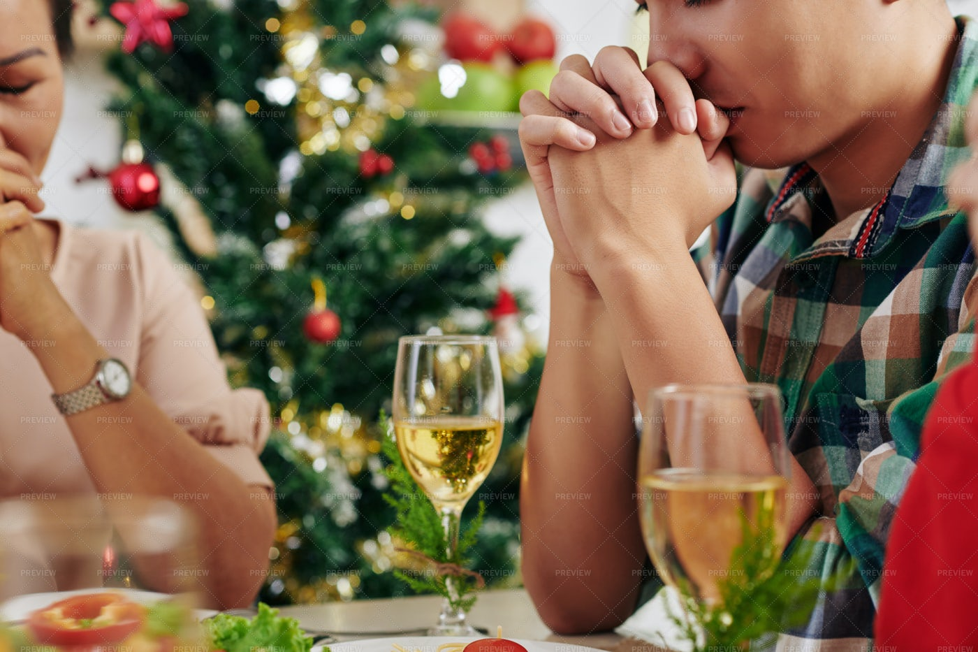 People Praying Before Dinner: Stock Photos