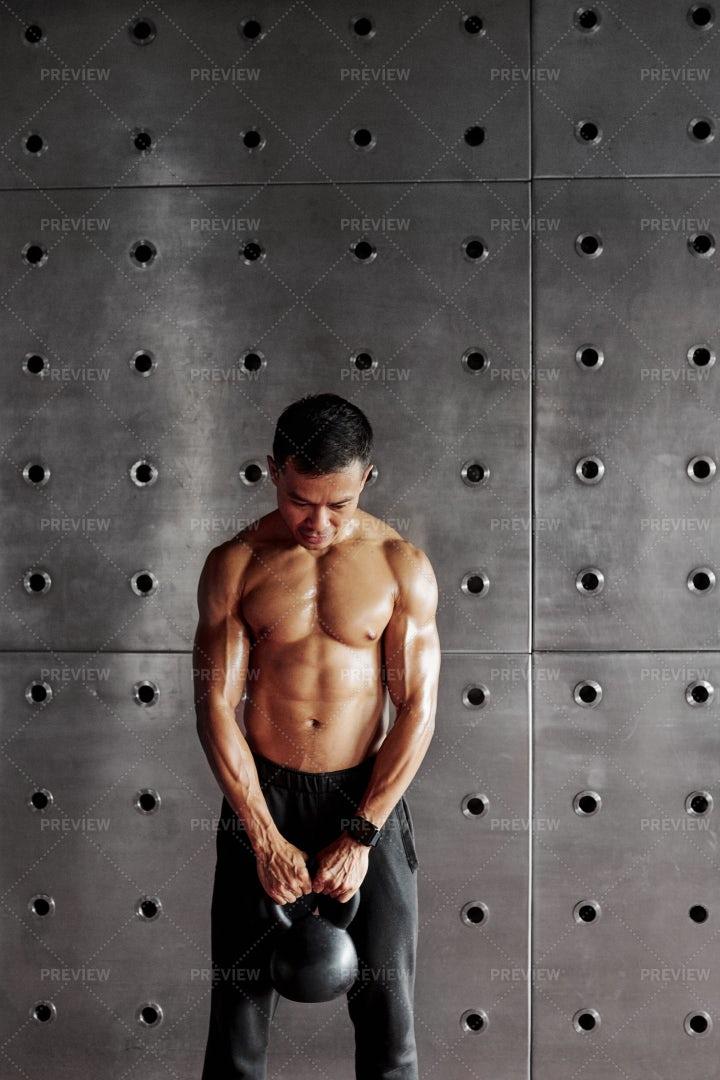 Man Holding A Weight: Stock Photos