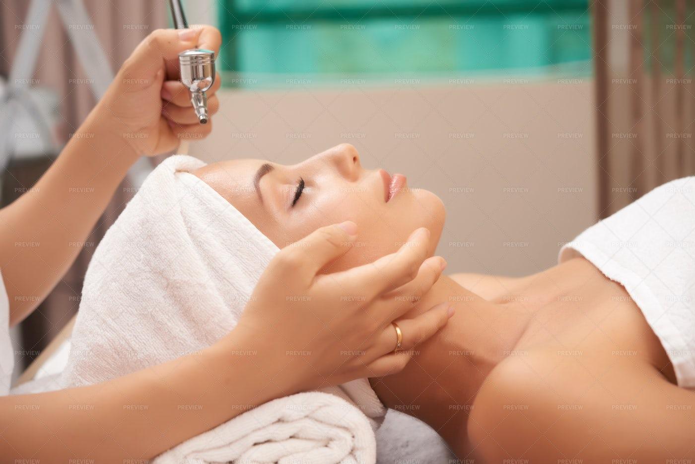 Woman Doing Rejuvenating Treatment: Stock Photos