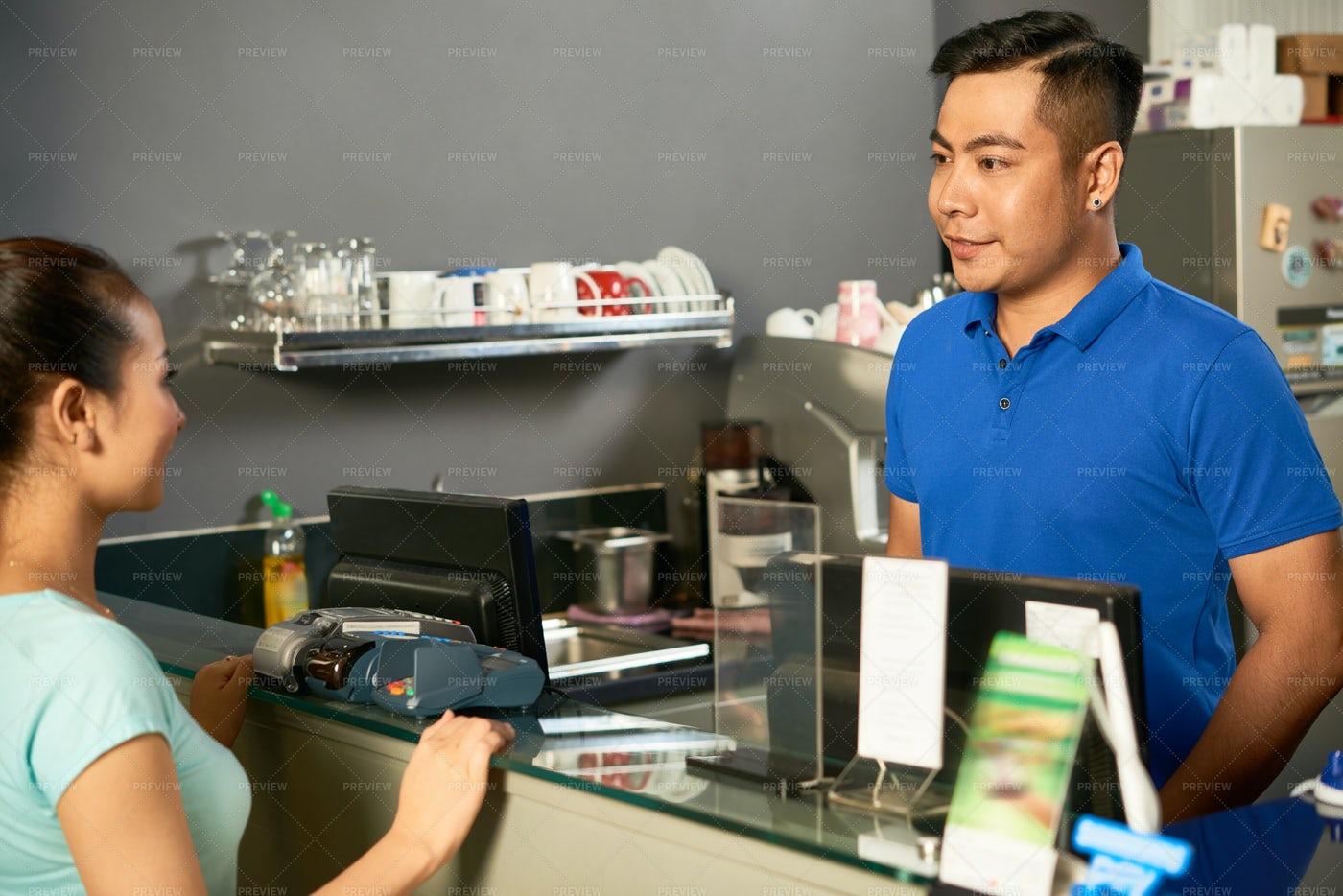 Talking To Cashier: Stock Photos