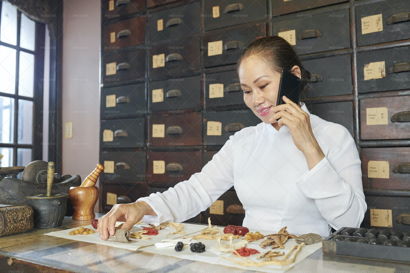 Traditional Asian Medicine Practitioner: Stock Photos