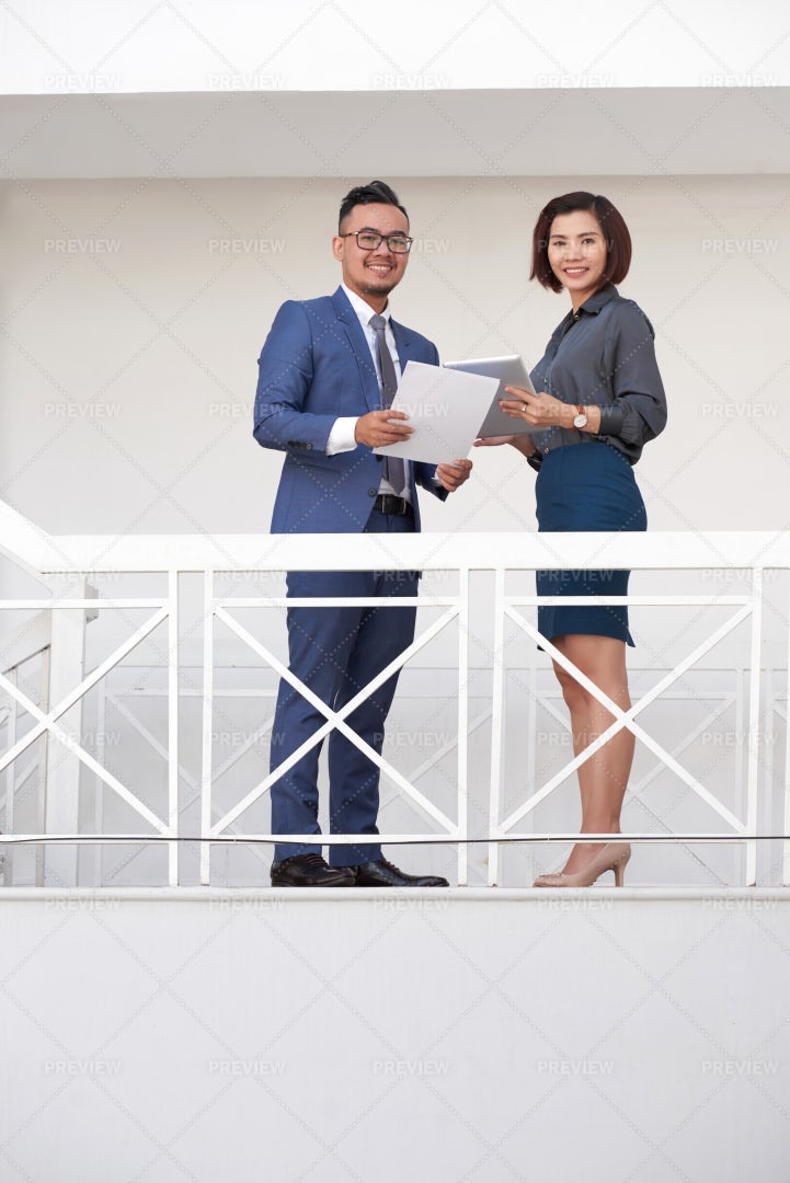 Business Partners Cooperating At Office: Stock Photos