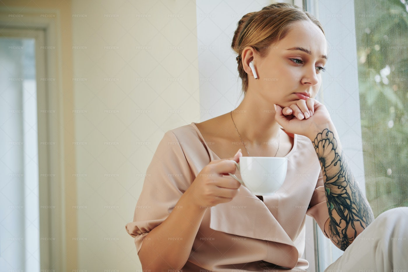 Woman Listening To Serious Audiobook: Stock Photos