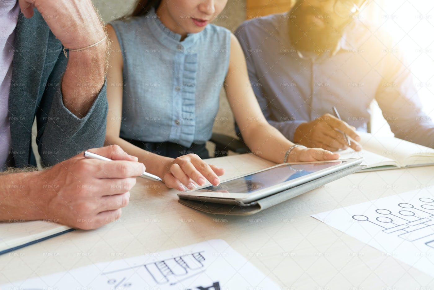 Colleagues Discussing Business Plan: Stock Photos